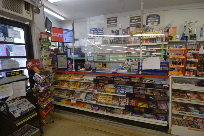 Cashier counter with treats, lottery tickets and a 'WE SELL BITCOIN' lamp