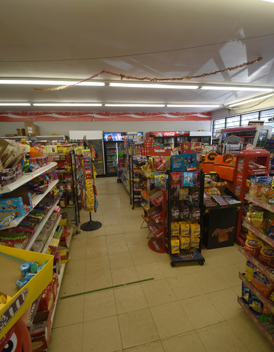Inside the store with chips and many treats like Mars, M&M, Reese and Twizzlers