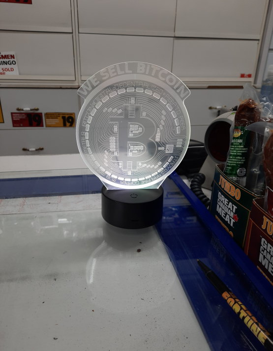 'WE SELL BITCOIN LAMP' at the counter of the store