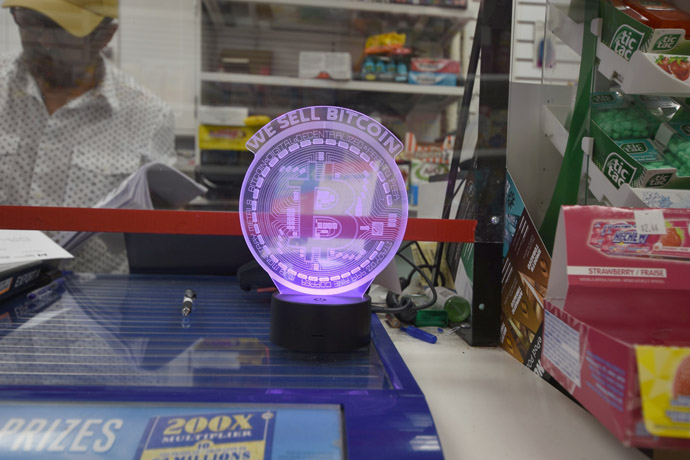 'WE SELL BITCOIN' lamp at the cashier counter