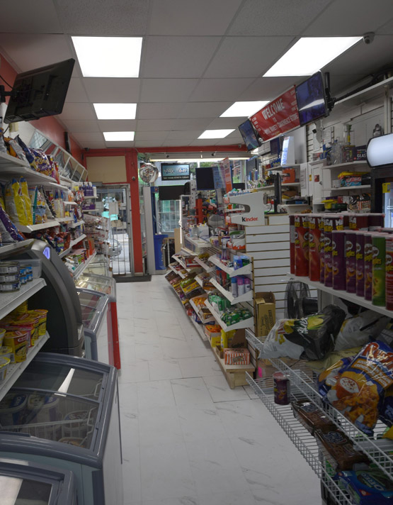 Small alley of the store where we see chips, instant noodles and a cash ATM