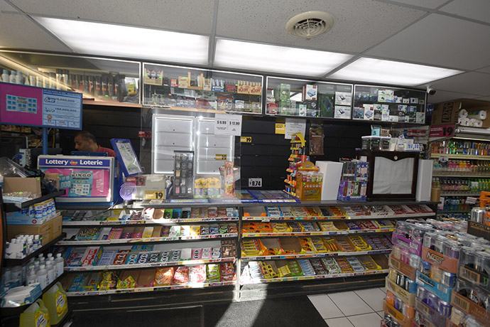 Cashier counter with many treats and a lottery screen
